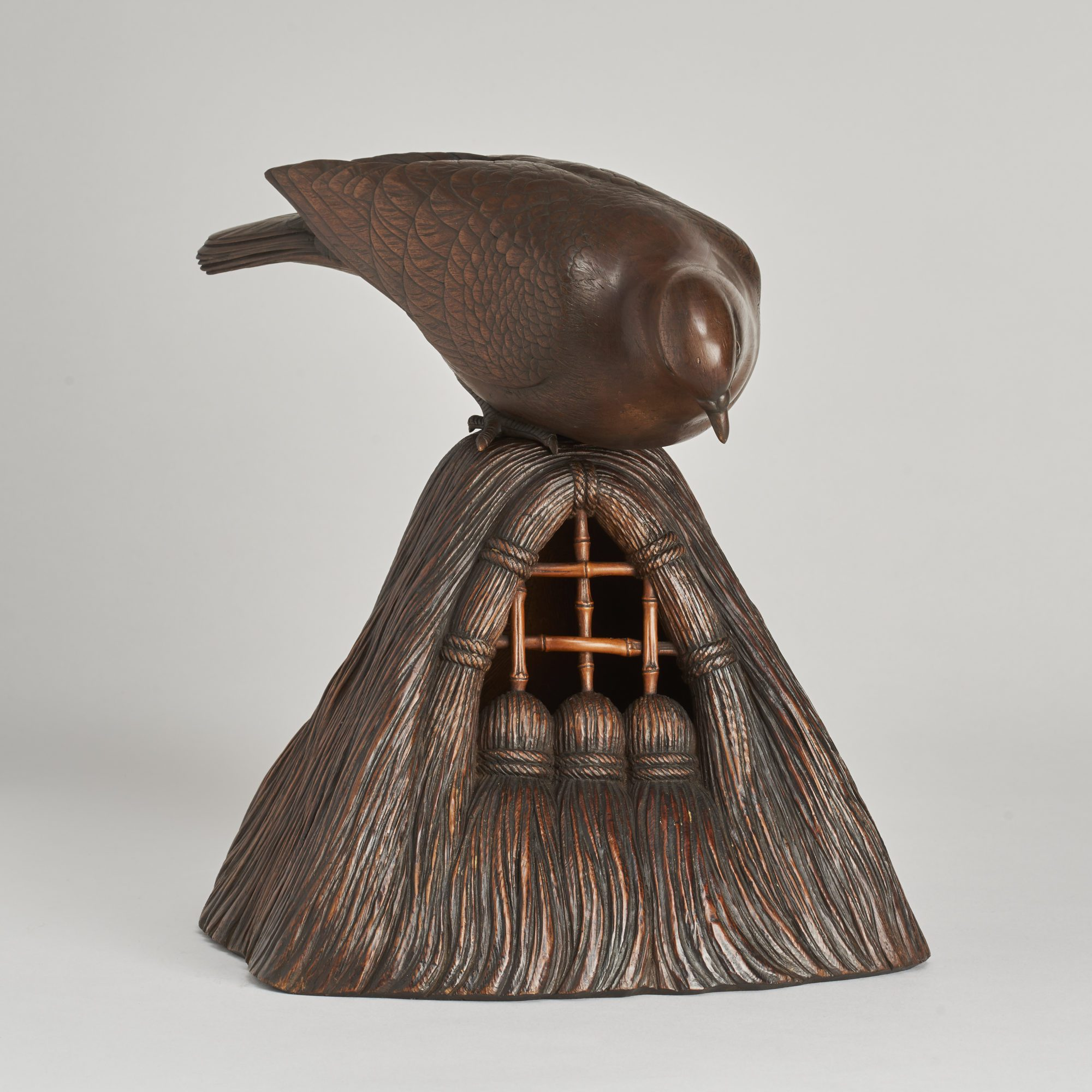 Japanese wood carving   A Japanese Meiji Period carved Wood Okimono of a Dove peering into a grain store