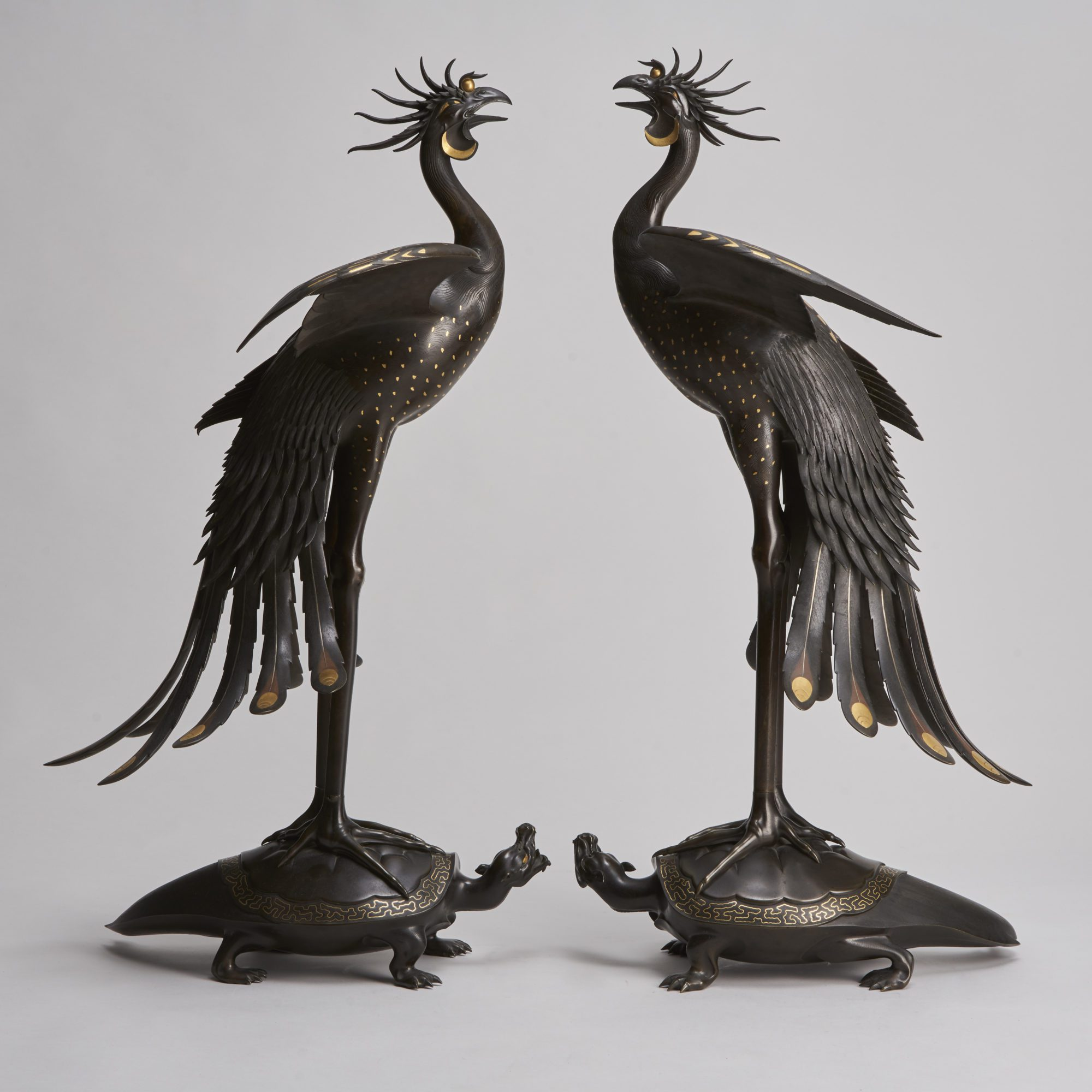 Pair of multi metal Phoenix   An exceptional pair of multi metal Phoenixes mounted on turtles (Japanese, 1868 – 1912)
