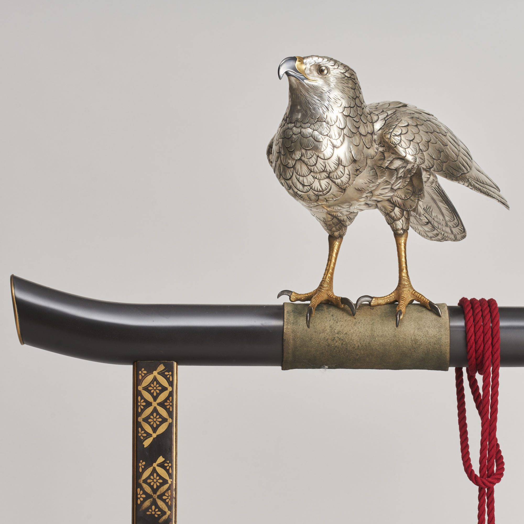 Silver hawk   A majestic, life-size silvered Bronze Okimono of a Hawk on a superb lacquer stand, (Japanese Meiji-era)