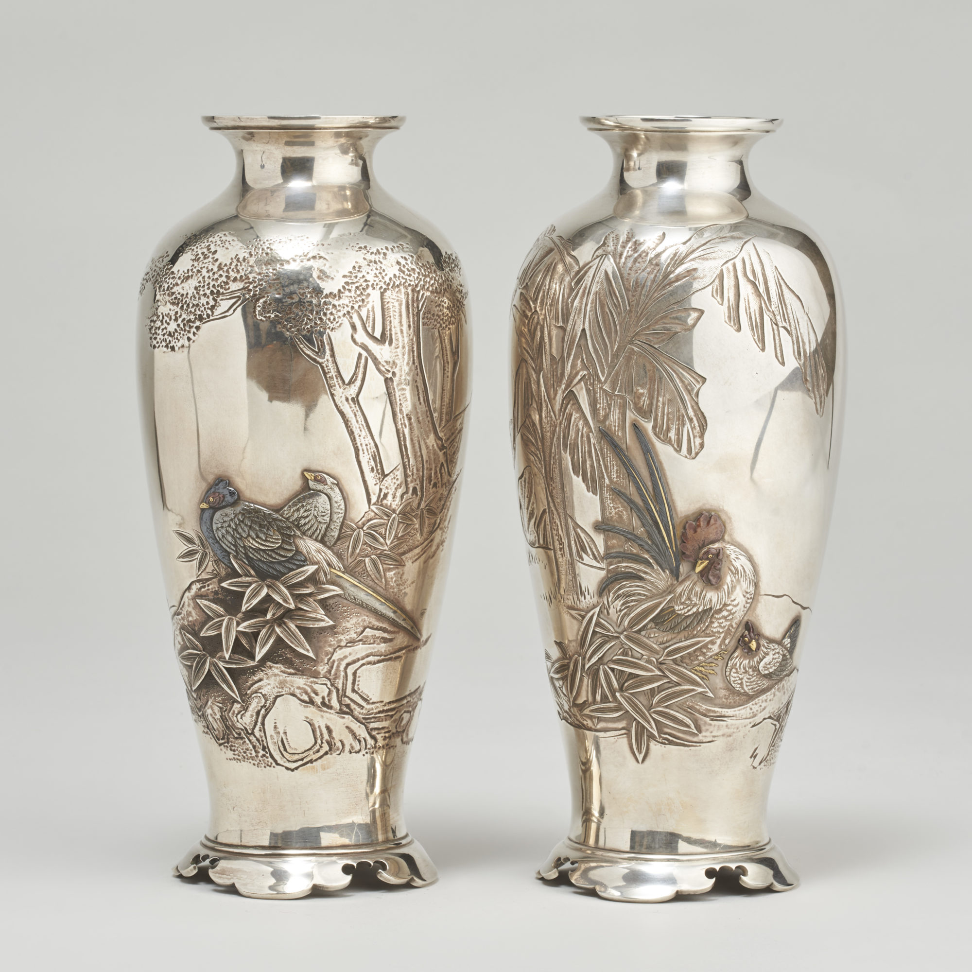Japanese silver ware   A beautiful pair of Japanese Meiji-era Silver vases (1868-1912)