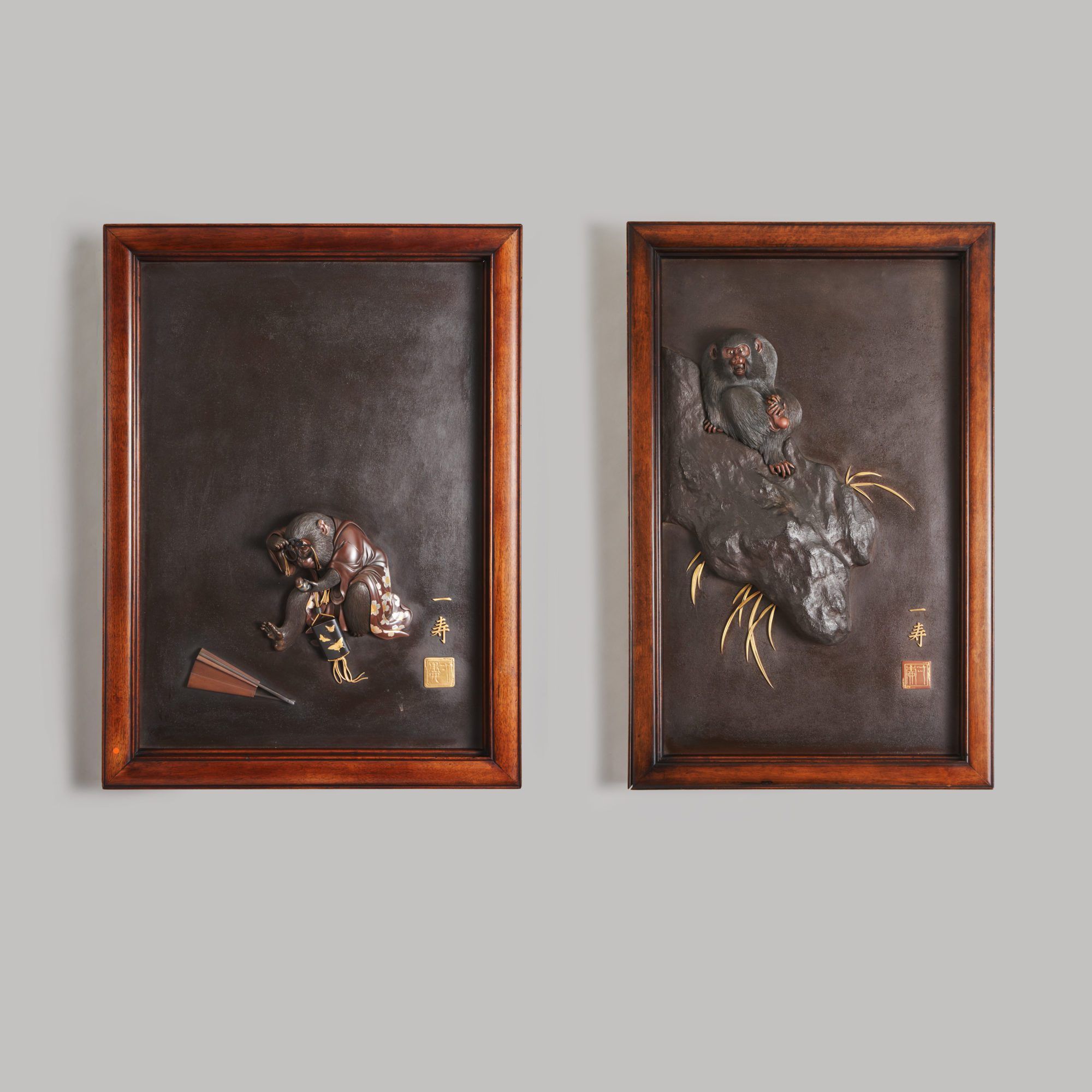 Meiji-era metalwork   An exceptional pair of Japanese, late 19th Century Iron, Bronze and multi-metal panels depicting Monkeys