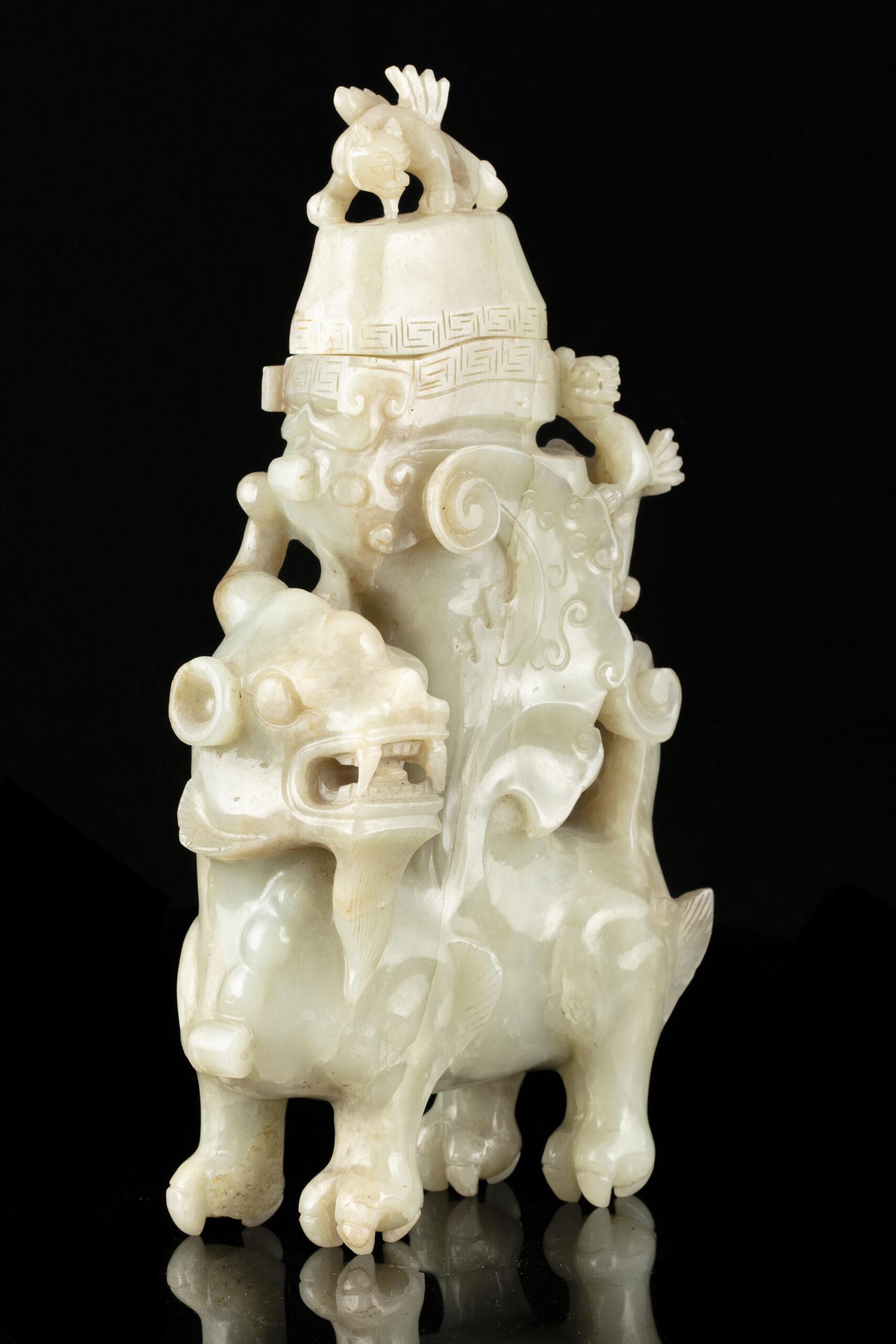 A JADE 'QILIN' ARCHAISTIC VESSEL AND COVER, RHYTON, CHINA, QING DYNASTY, 19TH C.