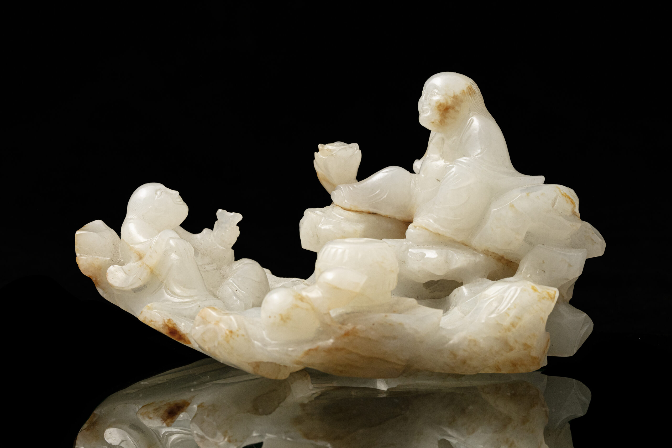 A JADE 'HEHE' GROUP CARVING, CHINA, QING DYNASTY, 19TH C.