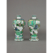 Pair of Chinese porcelain famille verte, wucai dated vases of meiping form, each painted with a scene of a provincial governor being reassigned and departing to his assigned post. 12 inches, 30.5 cm high. The bases with four-character marks, xinsi nian zhi, in underglaze blue within a double ring and of the period, corresponding to the xinsi year, 1701.